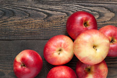 Some red apples on the table. Some red apples on the dark wooden table stock image