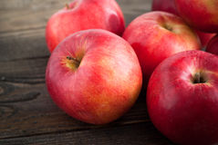 Some red apples on the table. Some red apples at the  wooden table Stock Photo