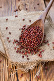 Some Red Beans. (close-up shot) on rustic wooden background Stock Image