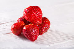 Some red berries of strawberry on white boards. Close up, horizontal shot Stock Images