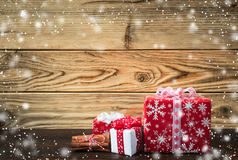Some red christmas gifts on wood Royalty Free Stock Photography