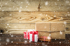 Some red christmas gifts on wood. Background Stock Photos
