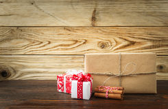 Some red christmas gifts on wood. Background royalty free stock photography