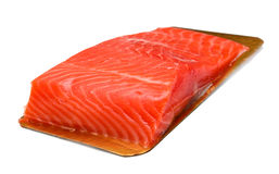 Some red fish. A piece of red fish on a board. Isolated on white Royalty Free Stock Image