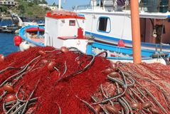 Fishing nets. Some red fishing nets in a pile royalty free stock photography