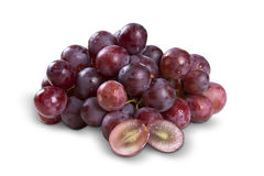 Some red grapes over a white background Royalty Free Stock Images