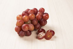 Some red grapes over a white background Royalty Free Stock Image