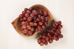 Some red grapes over a white background Stock Photos