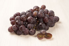 Some red grapes over a white background Royalty Free Stock Photography