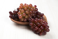Some red grapes over a white background Stock Photography