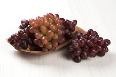 Some red grapes over a white background Stock Photo