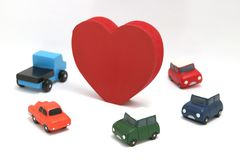 Some red hearts and cars on white background. 