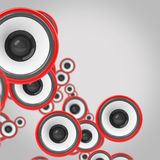 Some red loudspeakers on grey background Royalty Free Stock Images