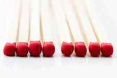Some red match heads. Closeup of some red match heads on white background stock photo