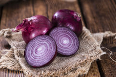 Some Red Onions. (detailed close-up shot) on wooden background Royalty Free Stock Photo