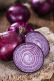 Some Red Onions. (detailed close-up shot) on wooden background Royalty Free Stock Photos