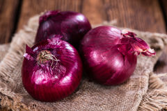 Some Red Onions. (detailed close-up shot) on wooden background Royalty Free Stock Photography