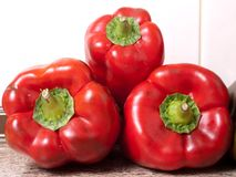 Some red peppers. A group of red bell peppers stacked stock image