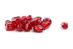 Some red pomegranate berries. Isolated on the white background royalty free stock images