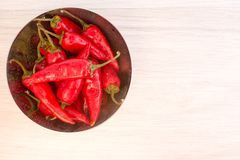 Some red spicy chili peppers. On wooden table stock images