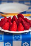 Some red strawberries in a plate Stock Images