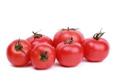 Some red tomatoes. Studio photo of fresh red tomatoes of different size in a big pile over white background on different concept theme Stock Photo