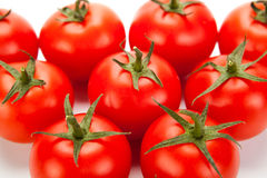 Some red tomatoes close-up on a white background Stock Photography