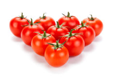 Some red tomatoes on a white background Stock Photography