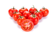 Some red tomatoes on a white background Stock Photos