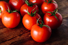 Some Red Tomatoes on Wooden Table Stock Image