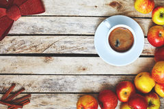 Some red and yellow apples on the white wooden table. Some red and yellow apples, Festive red bow, kitchen herbs and cup of coffee on the white wooden table Stock Photos