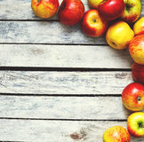 Some red and yellow apples on the white wooden table Stock Photo