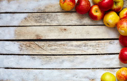 Some red and yellow apples on the white wooden table. Food and dietary concept. picture with free space for text Royalty Free Stock Photography