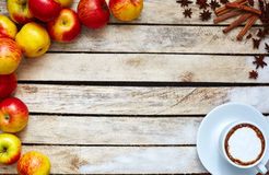 Some red and yellow apples on the white wooden table. Some red and yellow apples, sugar kitchen herbs and cup of coffee on the white wooden table. food and Royalty Free Stock Images
