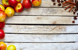 Some red and yellow apples on the white wooden table Royalty Free Stock Photos