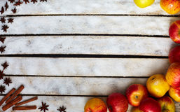 Some red and yellow apples on the white wooden table. Some red and yellow apples, sugar, kitchen herbs on the white wooden table. food and dietary concept Stock Images