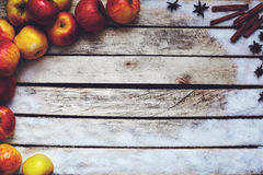 Some red and yellow apples on the white wooden table Royalty Free Stock Photo