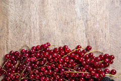 Some Redfruits over a wooden table. Royalty Free Stock Image