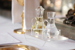 Some religious accessories. Bottles of wine and holy water royalty free stock images