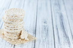 Some Rice Cakes. On an old wooden background (detailed close-up shot royalty free stock images