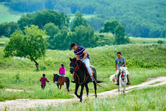 Some riders on the meadow. The photo was taken in huamugou national forest park Hexigten banner Chifeng city Nei Monggol Autonomous Region,China Royalty Free Stock Images