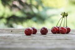 Ripe cherry fruits on wooden table Royalty Free Stock Images