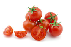 Some ripe cherry of tomatoes. And half Stock Photos