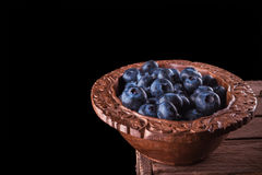 Some ripe and fresh blueberries in brown cup Stock Photography