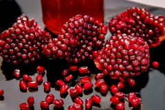 Some ripe juicy red pomegranate fruit on the plate. Punica gran Stock Photos