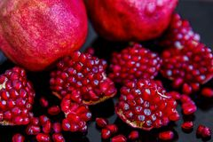 Some ripe juicy red pomegranate fruit on the plate. Punica gran Stock Photography