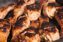 Some roast chicken drumstick on frying pan. Some juicy roast chicken drumstick on frying pan royalty free stock photo