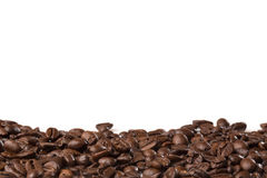 Some roasted beans  on white. Background with copyspace Stock Images