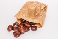 Some roasted chestnuts. On white background Royalty Free Stock Photos