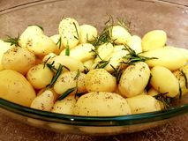 Some roasted potatoes on the pot. The roasted potatoes on the pot stock photo